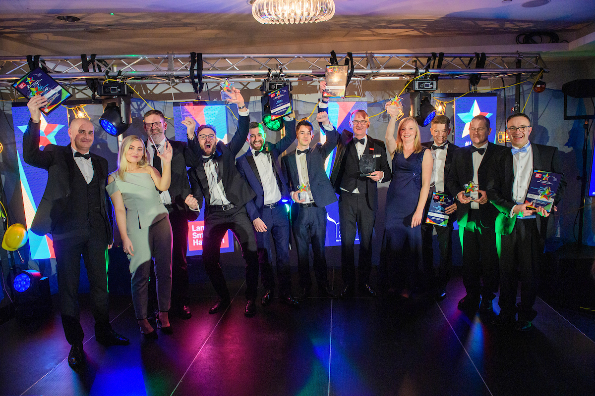 Picture of a group of men and women in formal evening wear holding trophies and celebrating at The Greater Lincolnshire Construction and Property Awards 2020