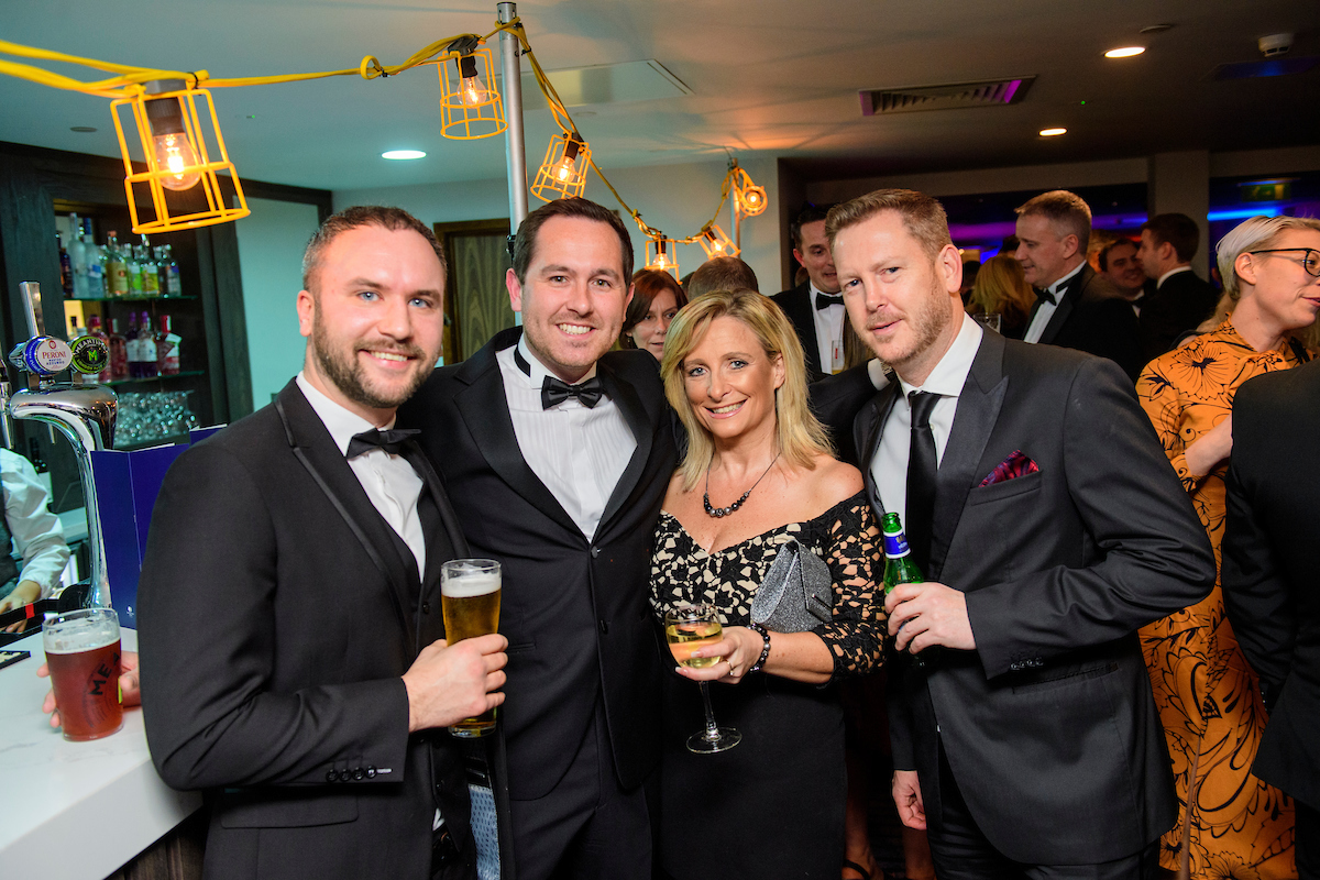 Group of people holding drinks at the bar during The Greater Lincolnshire Construction and Property Awards 2020