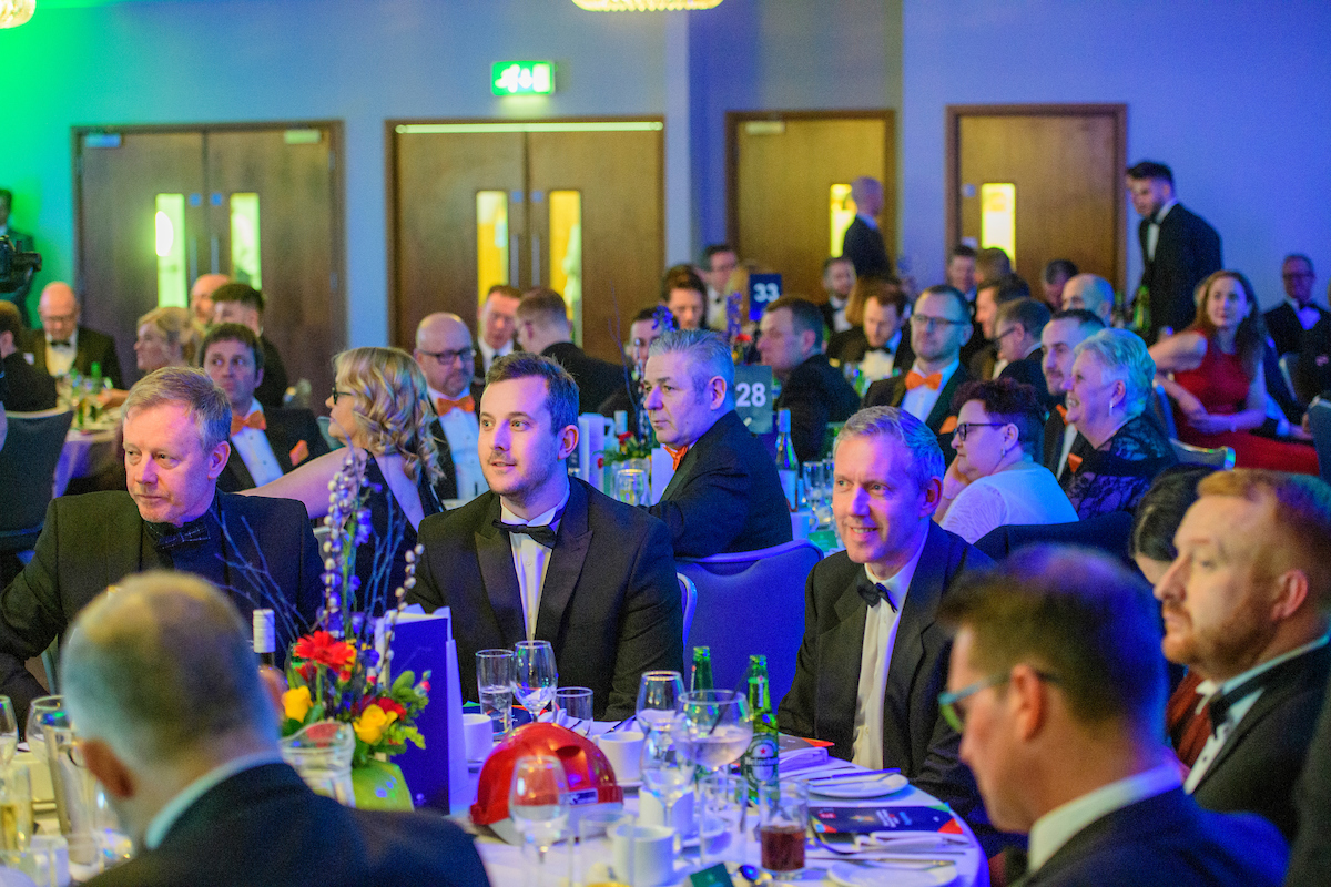 Group of people in eveningwear seated and watching the stage off screen at The Greater Lincolnshire Construction and Property Awards 2020