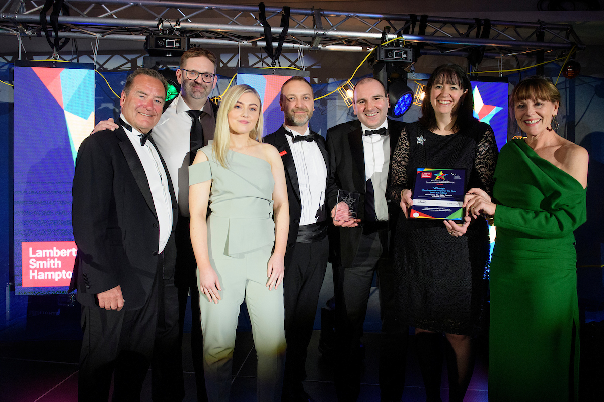Group of people wearing eveningwear holding trophy and certificate smiling at The Greater Lincolnshire Construction and Property Awards 2020