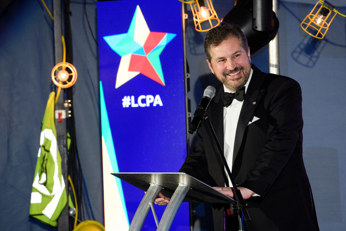 Gary Headland, Chair of the Lincolnshire Chamber of Commerce, wearing formal eveningwear on stage at The Greater Lincolnshire Construction and Property Awards 2020