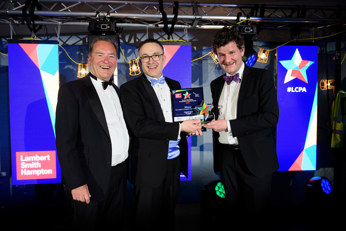 Three men in eveningwear smiling and posing with certificate and trophy at the Greater Lincolnshire Construction and Property Awards 2020