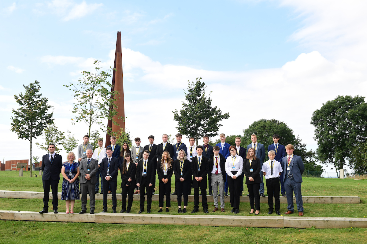 Group of men, women and students of IASTI Newark at the International Bomber Command Centre
